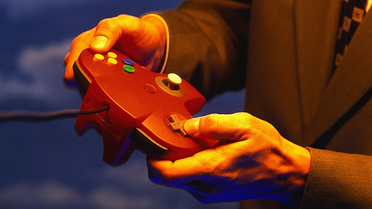 Businessman Using Video Game Controls