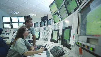 Scientists in accelerator control room --- Image by © Monty Rakusen/cultura/Corbis