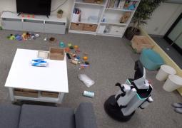 eşyaları toplayan robot